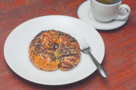 strew: Croissant bun with black sesame topping