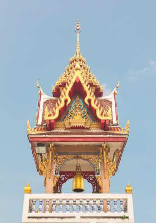 Buddhist temple belfry under blue sky