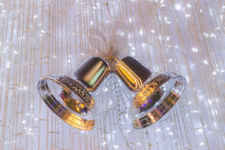 silver bells: Ornamental silver bells hanging on cristmas tree