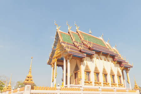 noon: Perspective view of Buddhist temple church under blue sky Stock Photo