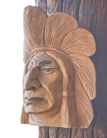 Carving wood Indian head on wood wall clipping on white backgrou Stock Photo