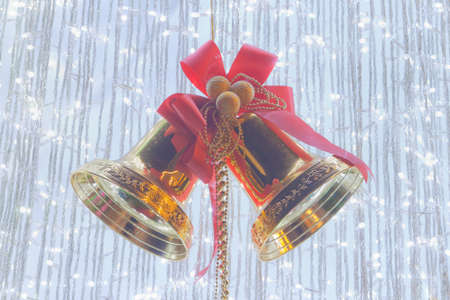 silver bells: Ornamental silver bells with red ribbon on cristmas tree