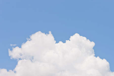 lite: Lump of white fluffy cloud on blue sky background
