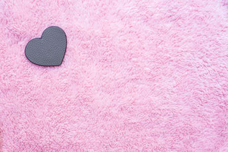 leather heart-shaped on pink artificial wool