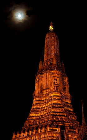 Thai buddhist golden stupa and full moon at night Stock Photo - 16888945