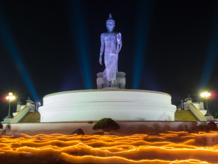 puja: Buddhism light waving rite in  Magha Puja, Asalha Puja and Visakha Puja Day at Thailand. Stock Photo
