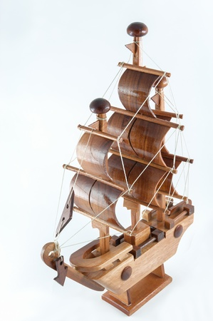 Wooden sailboat figure take money and lucky to  commercial. photo
