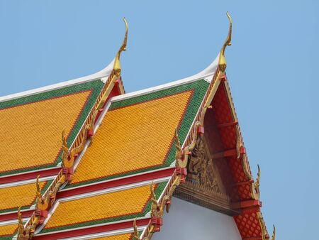 buddhist temple roof: Buddhist temple roof on blue sky in Thailand.