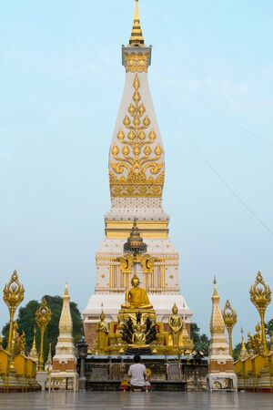 mystic place: Wat Phra That Phanom is the sacred precinct of the Phra That Phanom chedi located in the district of the same name in the southern part of Nakhon Phanom Province northeastern Thailand. Stock Photo