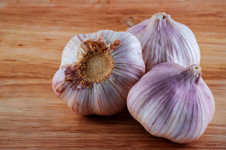 garlic has a characteristic pungent, spicy flavor that mellows and sweetens considerably with cooking. Stock Photo