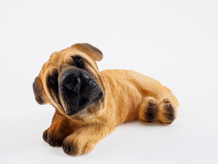 statuette: The statuette ceramic dog for gift or furniture or souvenir.