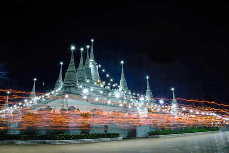 rite: Buddhism light waving rite in  Magha Puja, Asalha Puja and Visakha Puja Day at Thailand. Stock Photo