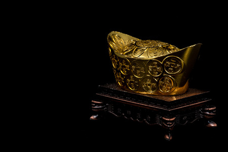 auspicious occasions: Chinese gold ingot is precious auspicious for occasion as happy chinese year. Stock Photo