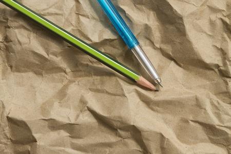 pen pencil on paper brown