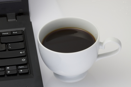 coffee and note book computer