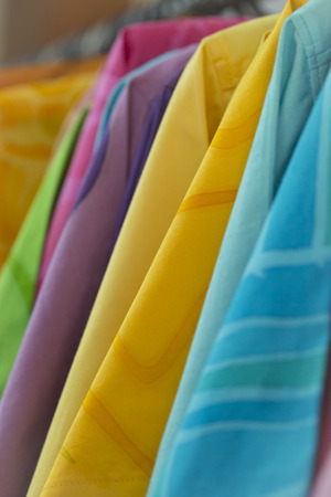 A  colorful clothes is show in the store.