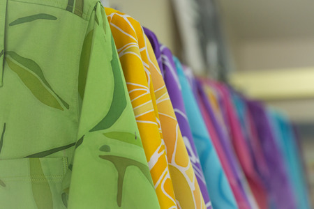 A colorful clothes is show in the store. Stock Photo