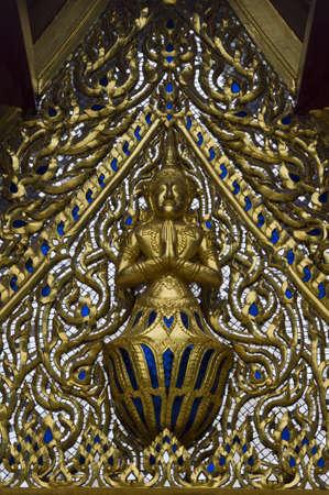 Thai angel on the Thai temple roof.