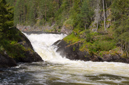 river rafting: Waterfall on the wild river in northern Finland in summer. Stock Photo