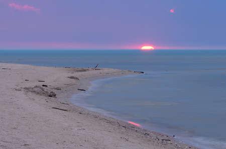 Colorful sunrise on the cape Kolka. Baltic sea.