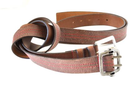 Two brown belts over white background