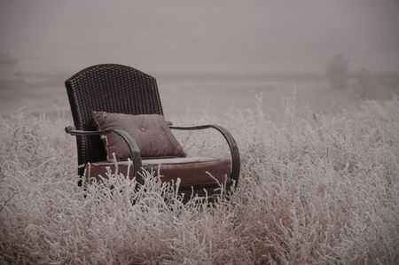 Peaceful empty chair in the winter frosted nature Stock Photo