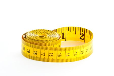 Roll of yellow measuring tape over white background