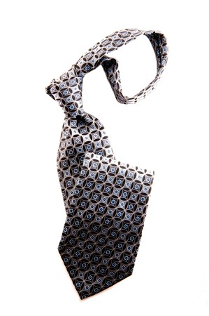 Gray, black and blue business necktie over white background. photo