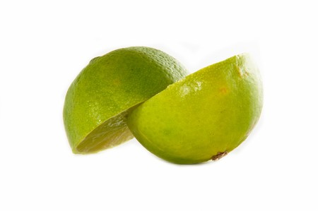 Bright green sliced lime over white background