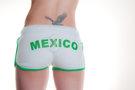 White shorts with word Mexico and model with eagle tatoo Stock Photo