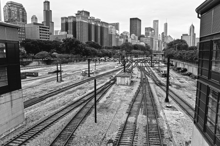 Empty railroad framed by the Chicago skyline