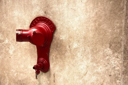 Bright red standpipe on a downtown Chicago wall photo