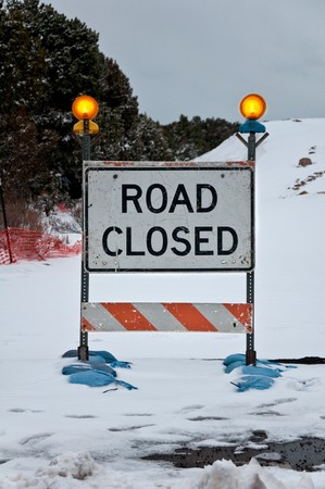 Snowy road closed sign at the Grand Canyon photo