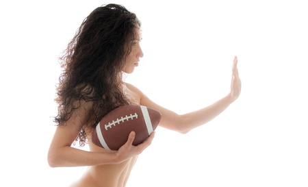 Beautiful woman holding a football isolated over white background photo