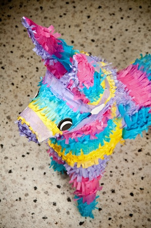 Colorful donkey pinata over blurred backgound photo
