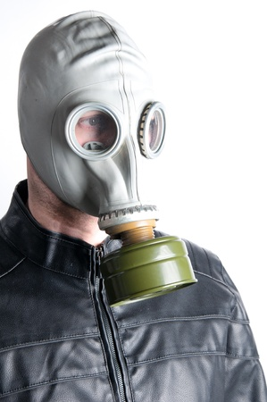 Men wearing a biker jacket and gas mask simbolizing danger in the environment Stock Photo - 11998524