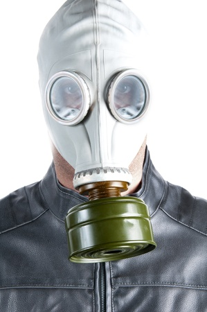 Men wearing a biker jacket and gas mask simbolizing danger in the environment photo