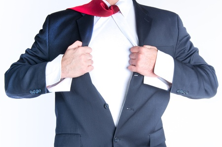Business man tearing shirt to become a superhero photo