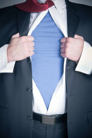 Business man tearing shirt to become a superhero Stock Photo - 12193476