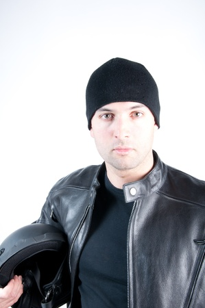 Young man wearing a biker leather jacket symbolizing a bike rider. photo