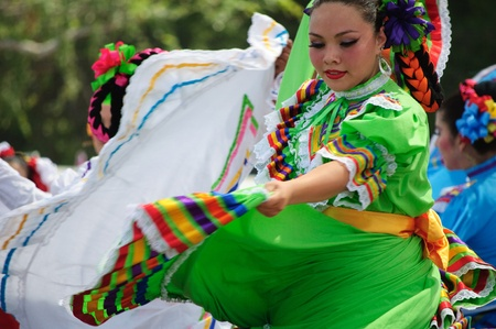 Orange County, CA, USA - July 2010  Mexican dancers performing in traditional latin american costumes Stock Photo - 12193896