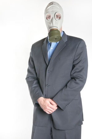 Men wearing a blue business suit and gas mask simbolizing danger in the environment Stock Photo - 12673333
