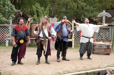 Kansas City, MO - October 12 2008: Unidentified Performers in traditional medieval costumes on stage at the Renaissance Fair  in Kansas City, MO - October 12 2008 Stock Photo - 13096546