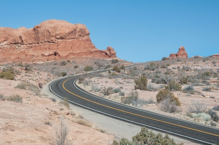 Empty desert road curve in the beautiful landscape of Utah photo
