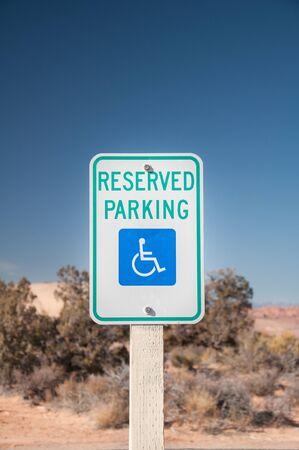 parking sign: Desert roadside traffic red stop sign under blue sky