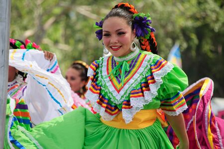 COSTA MESA, CA - JULY 24: Unidentified Mexican dancers perform in traditional costumes on stage at the Orange County State Fair in Costa Mesa, CA on July 24th 2010. Stock Photo - 14143578
