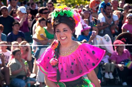 vestuario: Anaheim, CA - May 27 2011: Unidentified Mexican dancers perform in traditional costumes on stage at the Disneyland parade in Anaheim, CA on JMay 27 2011.