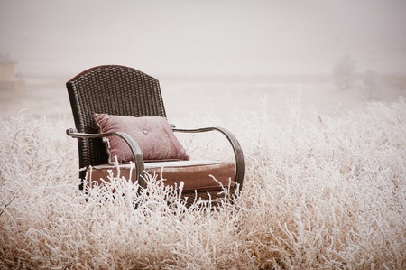 old furniture: Vintage chair ona morning frost after a night of snow