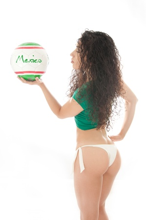 Beautiful model wearing green, red and white underwear holding a Mexico team ball isolated on white photo
