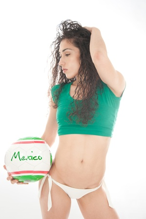 Beautiful model wearing green, red and white underwear holding a Mexico team ball isolated on white